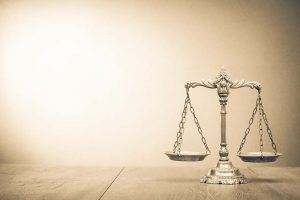 Retro law scales on table. Symbol of justice. Vintage style sepi